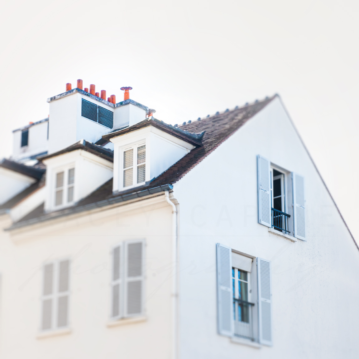 White house with orange chimney stacks in Montmartre Paris by Tracey Capone