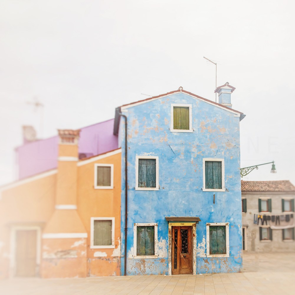 Photograph of colorful fishing homes on the island of Burano near Venice. Travel photography by Tracey Capone