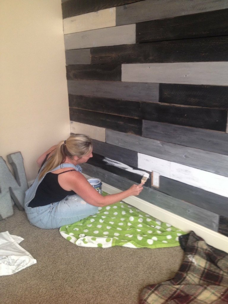 Tracey working in the corner of her Metallic Wood Plank Wall