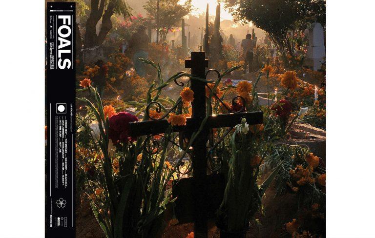 """Capa do disco """"Everything Not Saved Will Be Lost Part 2"""". A arte mostra um cemitério tomado por flores e árvores, e um crucifixo em foco."""
