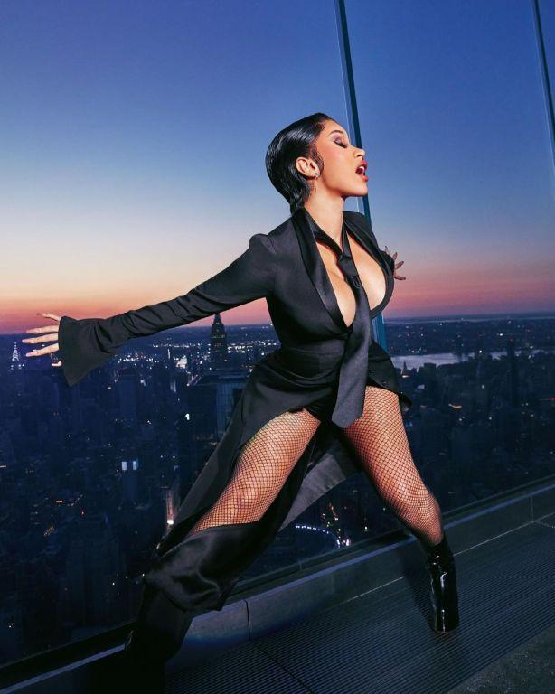 A imagem apresenta Cardi B em uma ensaio para a XXL Magazine. A cantora pode ser vista no meio da fotografia, vestindo roupas todas pretas. Atrás dela, há uma parede de vidro e pode-se ver uma cidade e o pôr do sol. A fotografia destaca o que podemos esperar do próximo álbum de Cardi B.