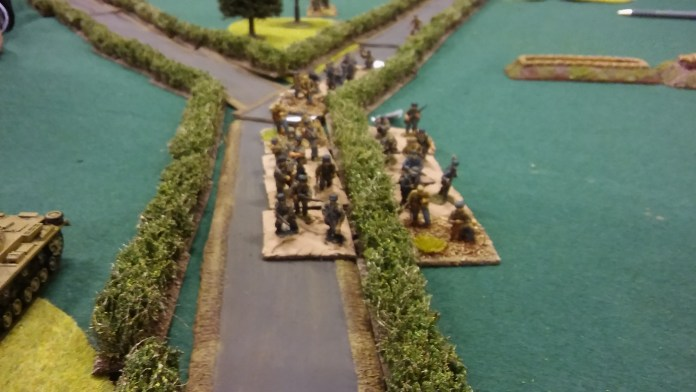 German advance down the road relentlessly carries on. Drawing MG and mortar fire.