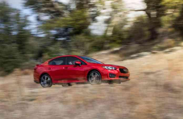 2017 Subaru Impreza rolling sideview