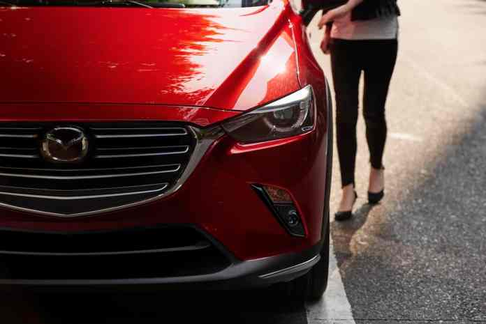 2019 Mazda CX-3 in red front headlight on street