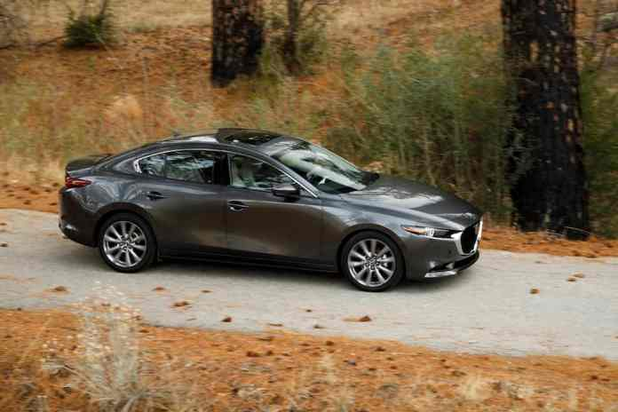 2019 Mazda3 sedan sideview in grey rolling down the road