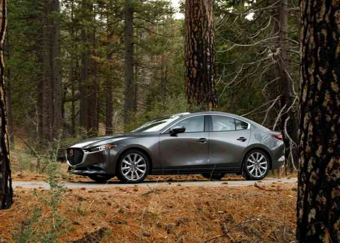 2019 Mazda3 sedan side view in grey in the forest