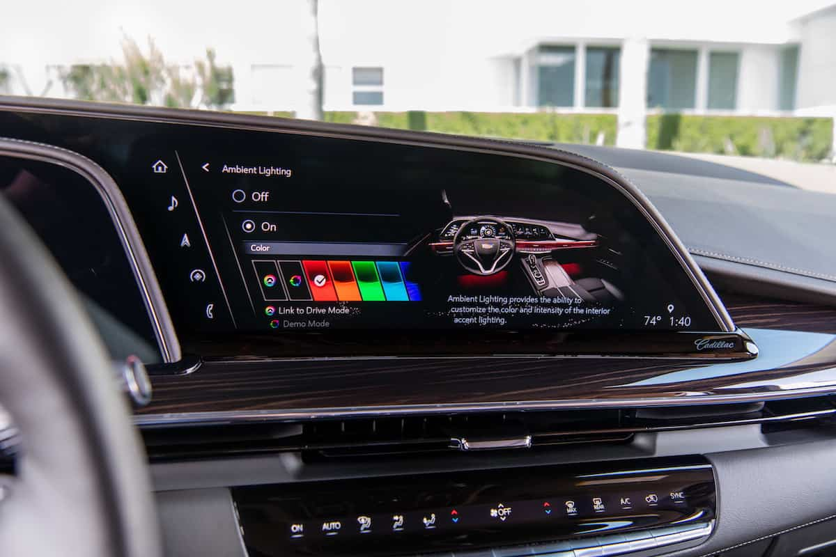 """The OLED display in the 2021 Escalade includes a 16.9"""" diagonal infotainment screen that displays and controls navigation, music, and many other functions of the vehicle, including customizable ambient lighting allowing drivers to change the color and intensity of the interior accent lighting."""
