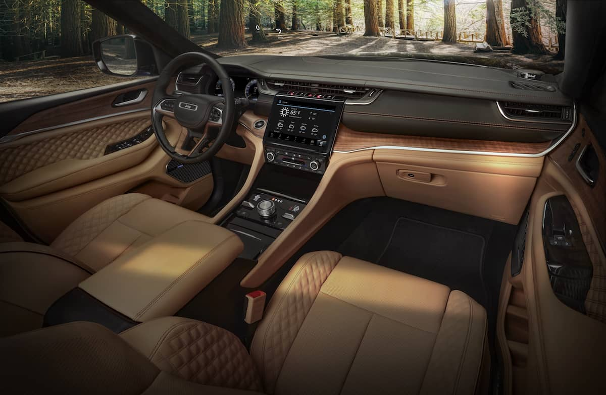 The all-new 2021 Jeep® Grand Cherokee L Summit Reserve model's spacious interior features standard 10-inch display screens, including a frameless digital gauge cluster and 10.1-inch Uconnect 5 touchscreen radio, hand-wrapped, quilted Palermo leather and open-pore Waxed Walnut wood accents, all-new LED lighting with ambient features, driver and front passenger seat massage and personalized climate zones.