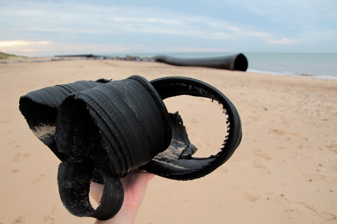 Larger fragment of plastic pollution from beached pipe on Norfolk beach