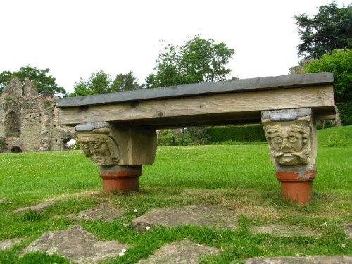 Bill and Ben (the flowerpot men) supporting a 'weedy' heavy bench in the gardens of Usk Castle