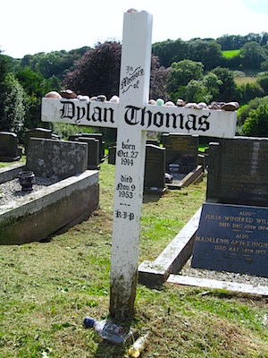 The poet's grave is marked with a simple white cross