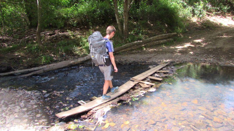 Harri leads the way across the river