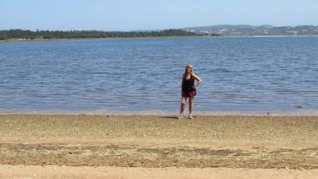 Tracy Burton stands on the pebble beach at the top of the Obidos lagoon near Caldas da Rainha