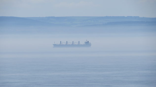Ship obscured by mist over Bristol Channel, South Wales