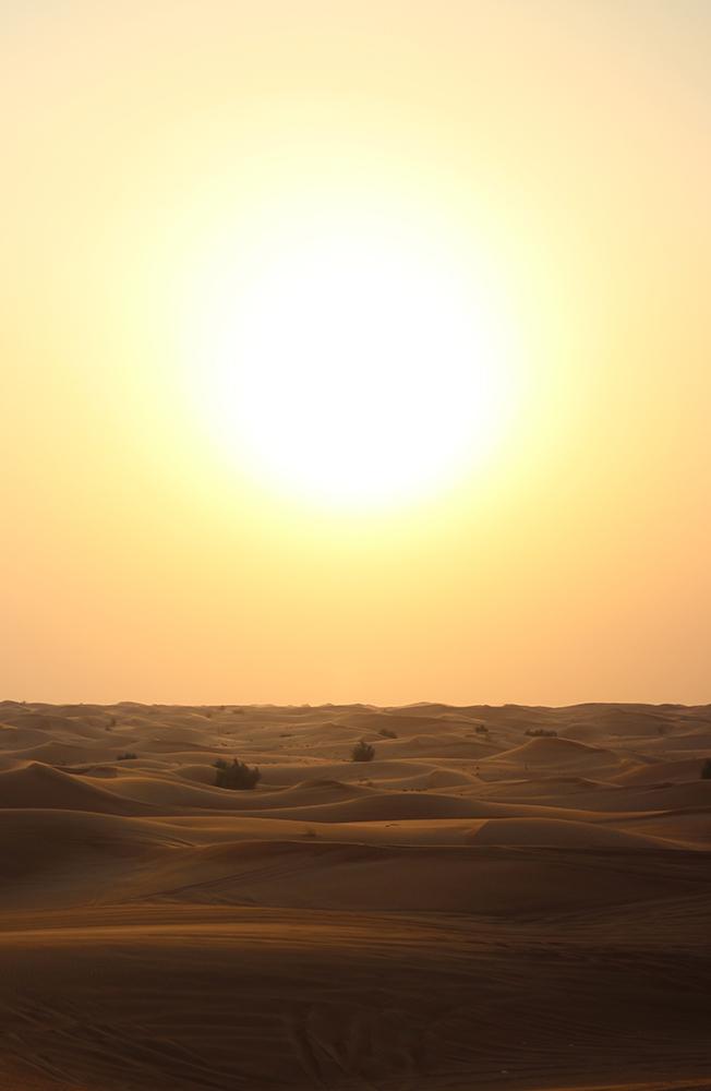 Sun over Dubai desert