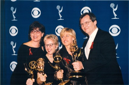 Group photo of Dava Savel, Tracy Newman, Ellen Degeneres, John Stark accepting Emmy Award for The Puppy Episode of Ellen Degeneres Show