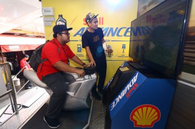 Trying out the bike simulator at the Shell Advance roadshow