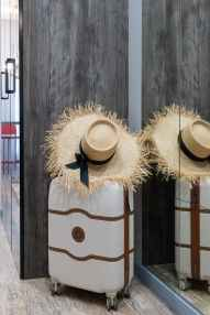 suitcase with straw hat in corridor
