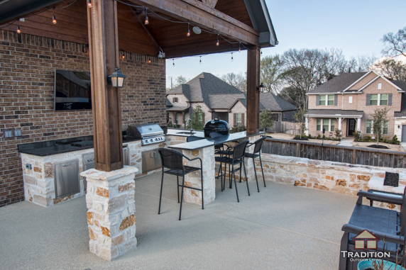 covered patio with outdoor kitchen in