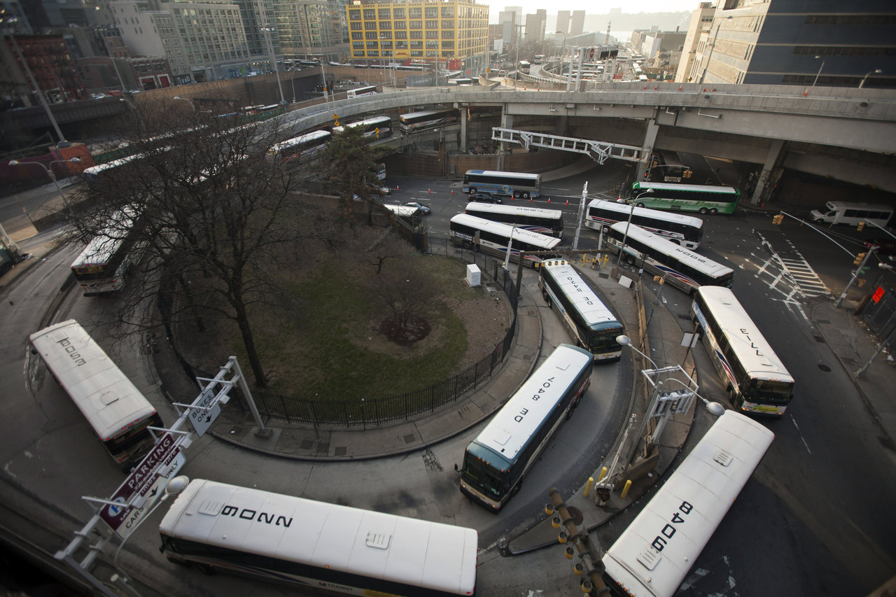 Buses wait in line to enter the Port Authority Bus Terminal last April. PHOTO: BLOOMBERG NEWS