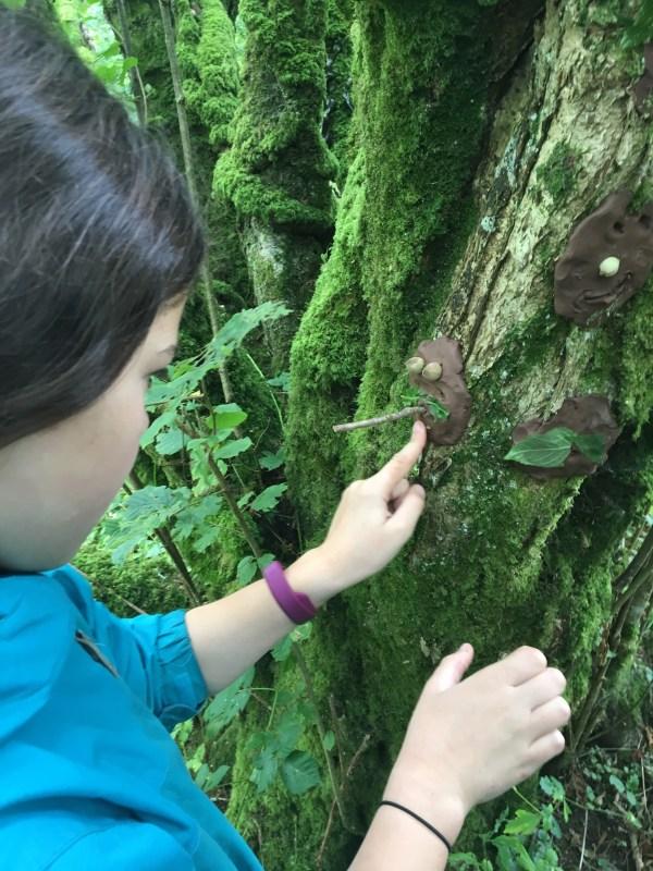 girl making a tree spirit