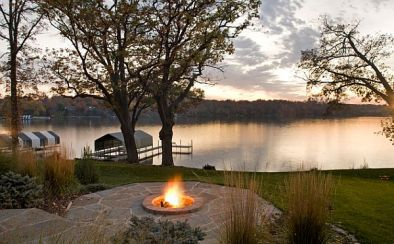 lake-house-with-an-outdoor-patio-and-firepit