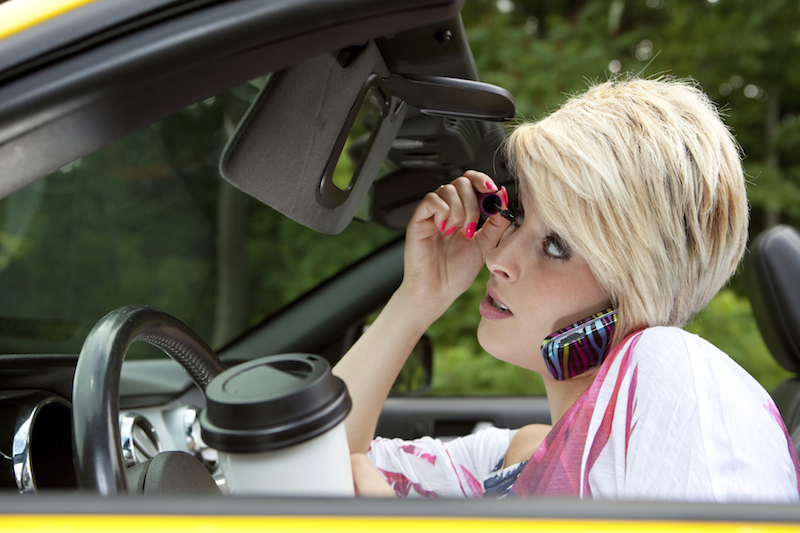 Image result for multitasking car drivers pictures