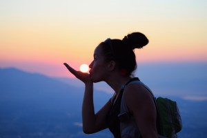 picture of andrea martinez at sunset on grandeur peak in Salt Lake City Utah