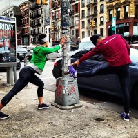 Picture of Robin Arzon and fellow runner stretching along a street