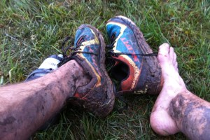 picture of muddy legs and scott shoes after a wet trail run mark kreuzer