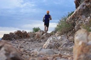 picture of aaron williams runnign toward rocks at mount olympus salt lake city utah