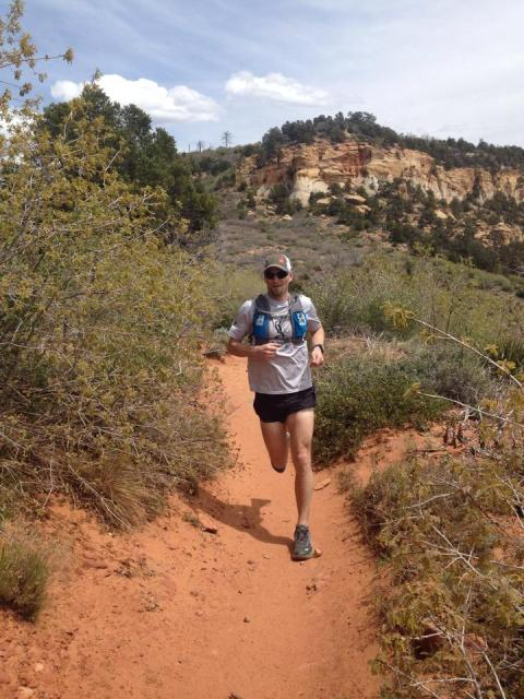 Craig Lloyd Running in Zion National Park wearing the Ultimate Direction AK Signature Series Vest