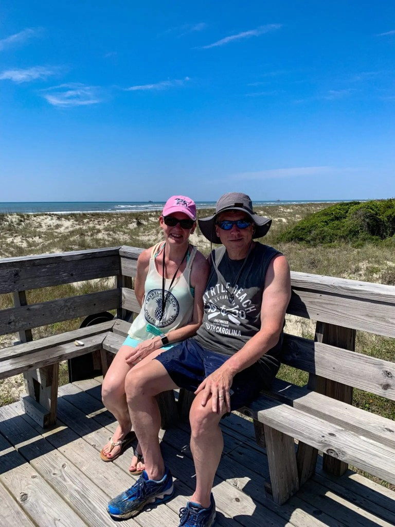 Couple Sitting at Shack looking over the beautiful beach of Waities Island in North Myrtle Beach, South Carolina