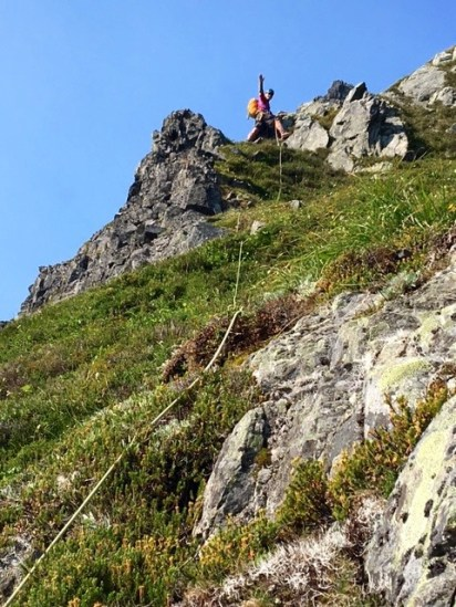 Jim Belaying Above Steep Heather