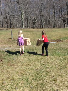 Children cleaning up trash in the park