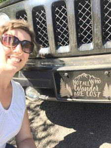Woman posing in front of Jeep
