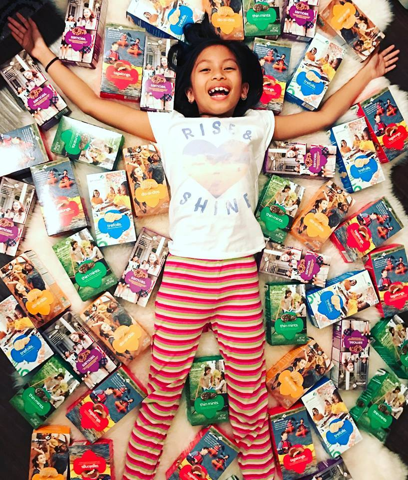 Girl Scout in Pile of Cookies