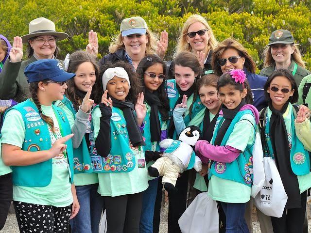 Girl Scout Rangers and GSNorCal CEO Marina Park holding up the Girl Scout sign