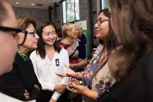 CEO Sylvia Acevedo with Girl Scouts