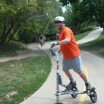 Trikke rider on boulder creek path