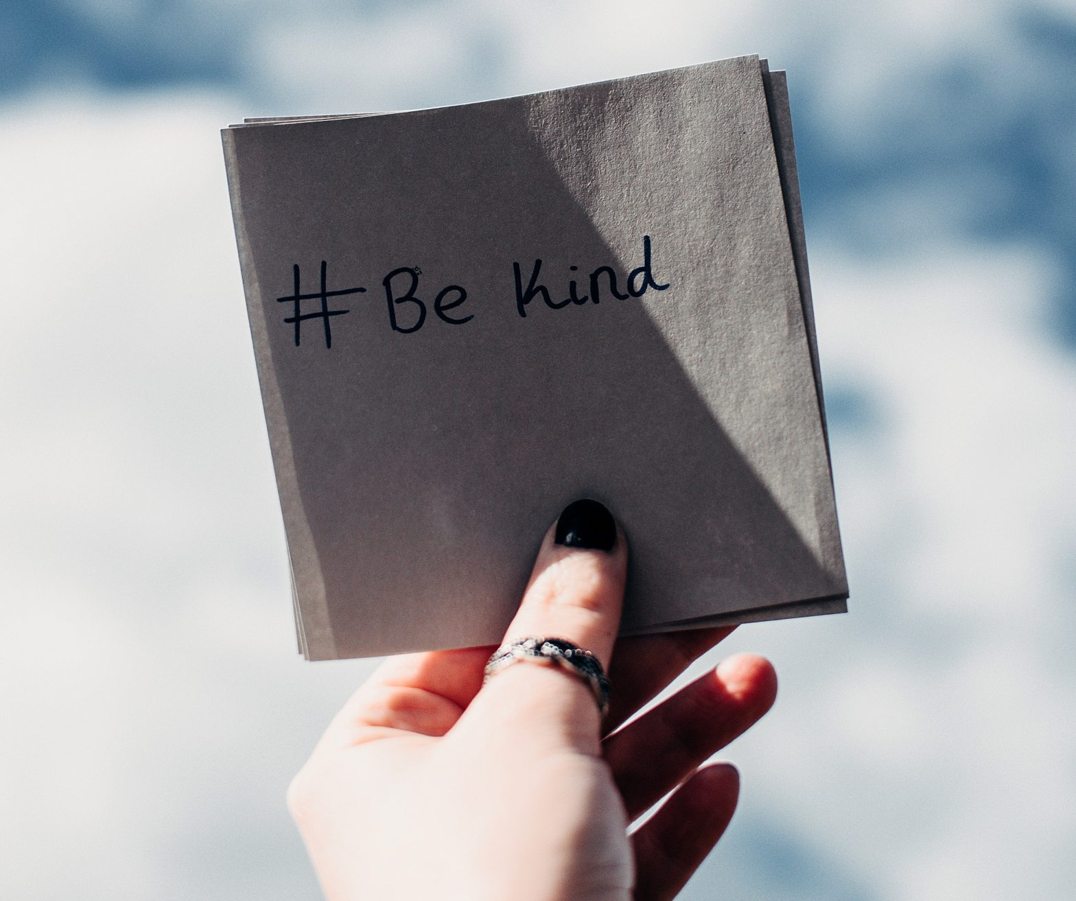 Hand holding #BeKind message