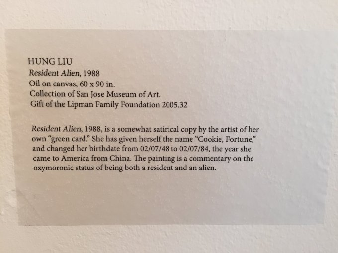 The museum plaque about the painting Resident Alien