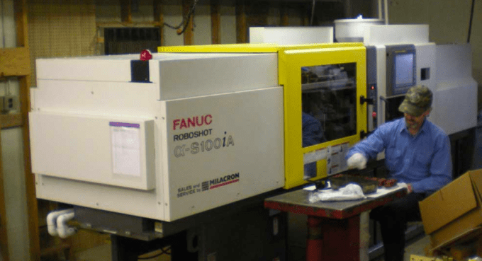An injection molding machine at the  Bowser Model Train Company  in Montoursville, Pennsylvania. Photo by Bowser Model Train Company
