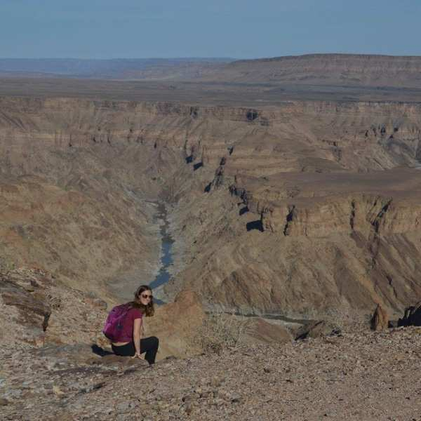 If you're going to sit on the edge of Africa's largest canyon, you may want travel insurance