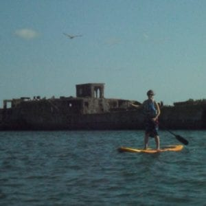 Low-risk adventures like paddleboarding are covered in most policies
