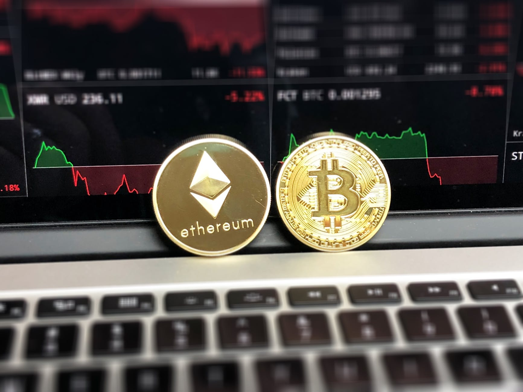 ethereum and bitcoin emblems