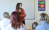 Actor Aoife Spratt filming a scene in the classroom.