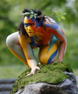 "Reanna Roane, as ""Ariel,"" perches on a rock in Central Park during the Outdoor Co-Ed Topless Pulp Fiction Appreciation Society theater company's performance of Shakespeare's ""The Tempest,"" Thursday, May 19, 2016, in New York. This ""stripped-down"" version of Shakespeare's play features an all-female cast of 13 actors, dancers and musicians celebrating body freedom and free expression. The performance uses nudity to dramatize the conflict between the visitors to Prospero's island and its inhabitants. (AP Photo/Kathy Willens)"