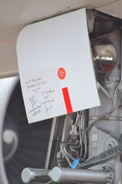 """Passengers of """"Zero G's"""" last flight ever wrote their names on one of the hatches."""
