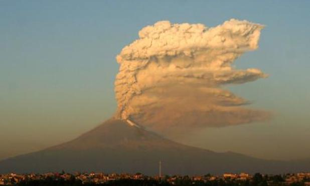 A three-kilometer-high plume erupts from the Popocatepetl volcano, east from Mexico City.